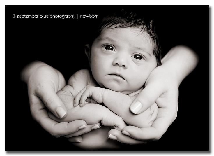 Newborn baby in hands