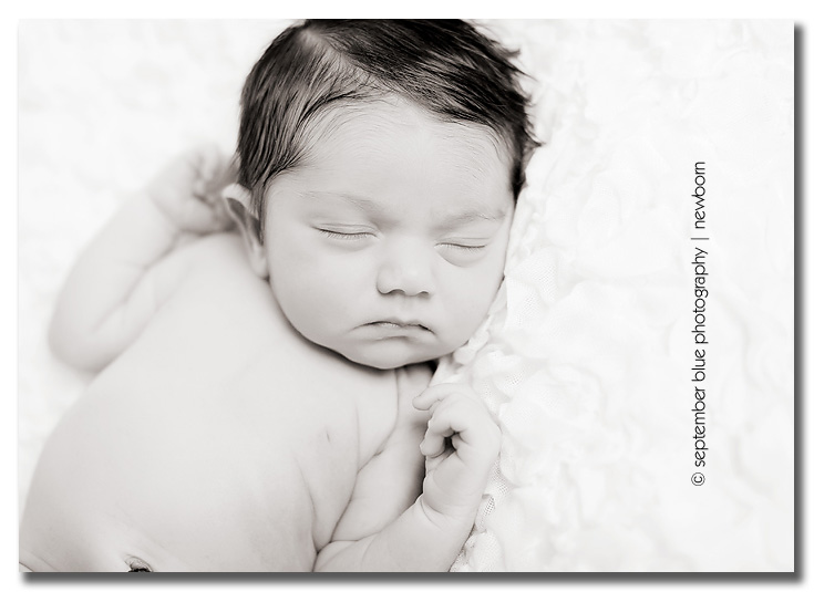 black and white sleeping newborn